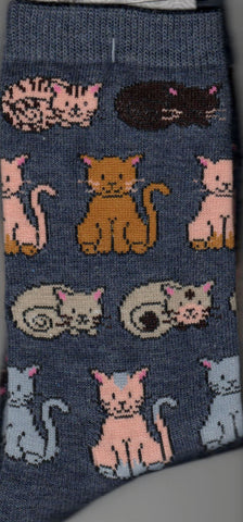 MHS Cats Laying Down and Sitting in size Medium has lots of different colored cats all over this sock either laying down or sitting and all have very pink ears.