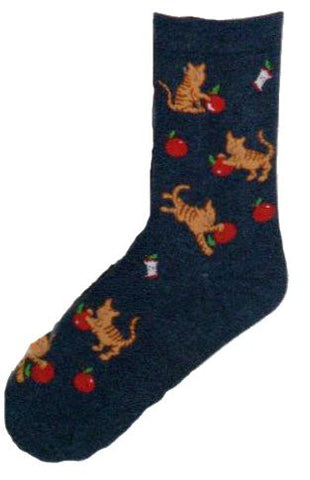 On a Dark Denim background a Brown Striped Cat is playing with a Bright Red Apple all over the sock.