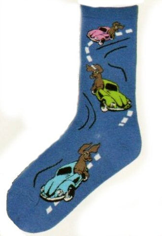 Three cars going down a road with dogs hanging out of the car window having lots of fun on this Blue Sock.