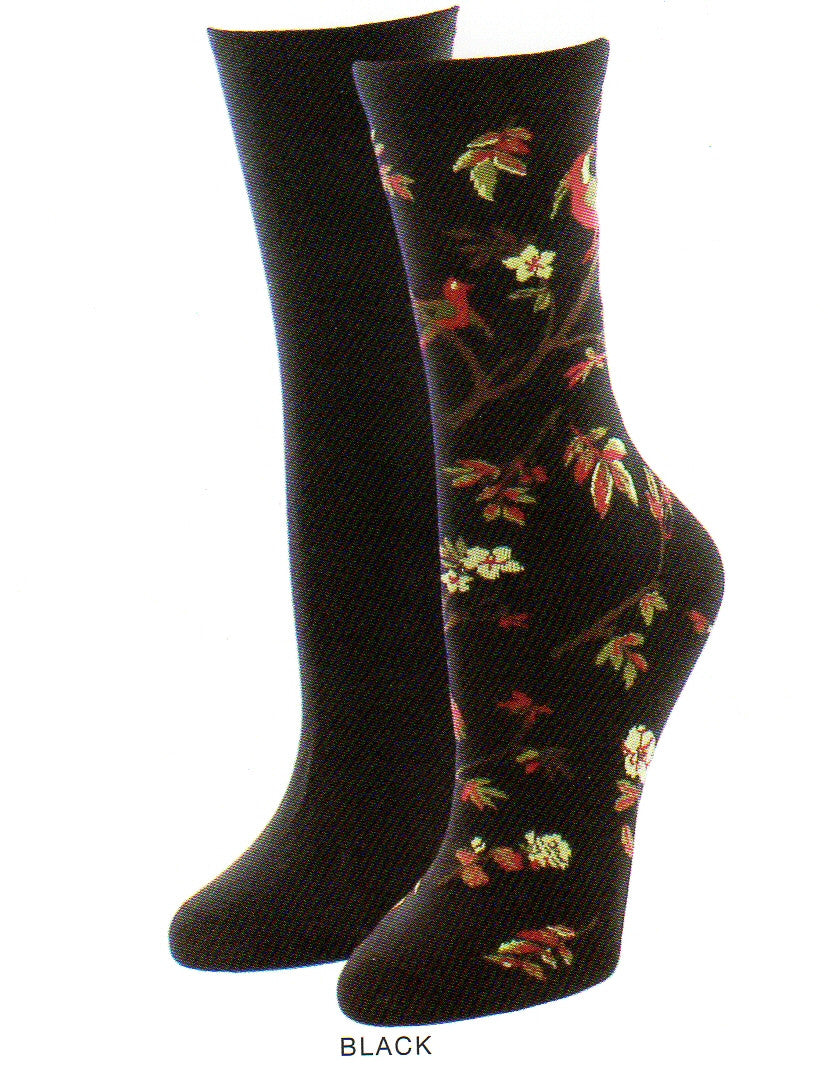 Me Moi Exotic Birds Socks 2 Pair Pack has one Black Sock and then the other is the Exotic Bird Sock. It starts with a Black background and has a Tree with Brown Branches and Red with Olive and Cream Leaves as they turn towards fall they also go Brown. The Flowers are Cream Colored with Five Petals and Maroon Stamen. The Bird is Maroon with a Cream Face and has Medium Grey and Dark Grey Feathers at the Breast and some at the Tail.