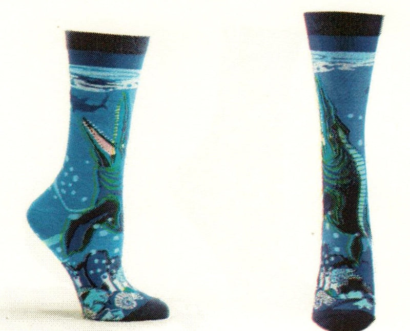 The Prehistoric Mosasaurus is the topic for this sock. All in Blues the Mosasaurus is Green, Navy and Black climbing from the bottom of the ocean floor to feed on its catch of the day!