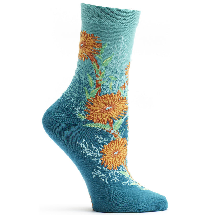 Ozone Bubbling Blooms Turquoise Sock is Turquoise on Top and Teal going down to the Toes. The Blooms are Orange and Flame and Teal Anemones. With Cyan Fans of Coral and Mantis Green Blades of Seaweed.