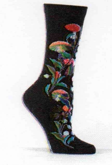 Ozone Womens Amanita Muscaria Sock starts with a Black background. The Sock shows a Black Berry Bush with Violet Fruit and Green Vine. This is mixed in with the Mushrooms of Red Caps with White Warts. The stems are Brown or White and Gills are Green.