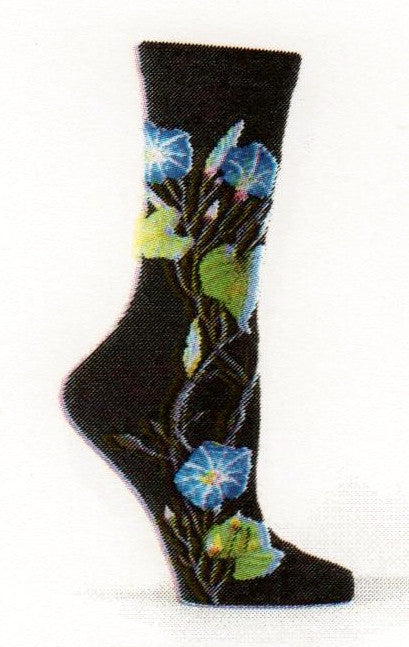 Ozone Womens Morning Glory Socks start on a Black background with the Morning Glory showing itself as a Vine with Leaves of Greens, Buds in Yellow and Pink and Flowers in Blues.