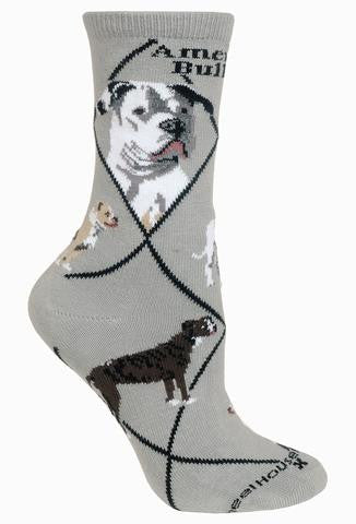 Wheel House Designs American Bulldog on Grey has Black Lines that make diamonds over the sock. Below the Cuff reads, American Bulldog in bold Black letters. Then come the Portraits a front and side profile. The Poses show White and Tan, Brindle and Tan and White colored American Bulldogs.