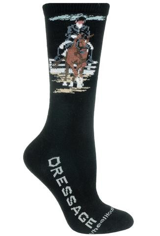 Wheel House Designs Dressage Sock starts on a Black background. Dressage is spelled out in Grey Bold Print on both sides of the Foot. The Rider and Horse are Decked out in Finery. This is an event where the Rider is in Formal Wear. The Horse is Chestnut and Black Mane is Braided.