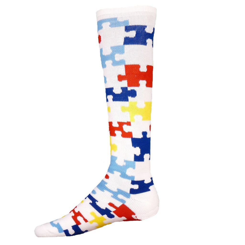 Red Lion Knee High Puzzle Sock starts on a White background with Light and Dark Blue Puzzle Pieces, Red and Yellow and White becomes a piece too. In Small and Medium Sizes.