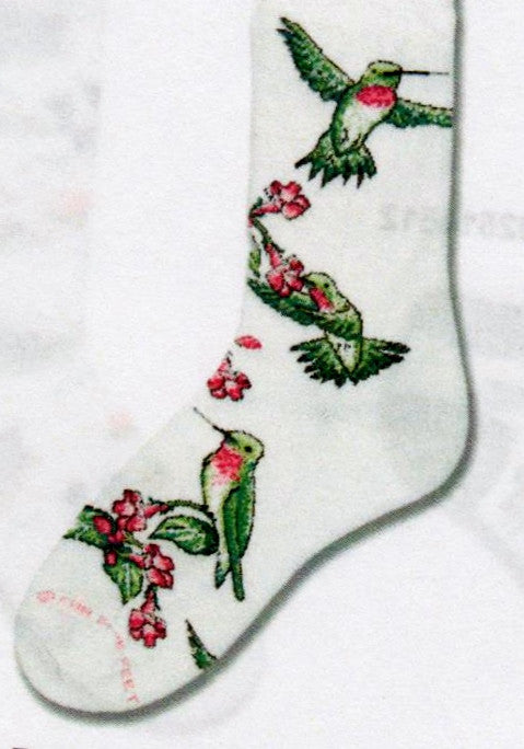 FBF Ruby Hummingbird Sock starts on Bright White with flying and stationary Hummingbirds on Fuchsia Plants