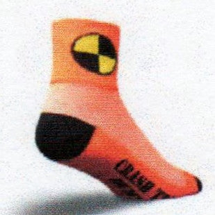 This Sock is Called Crash Test Dummy. The Yellow and Black Round Circle symbol is for Crash Test Dummies. It is on a Bright Orange Cuff. The breathable mesh is next in Orange and White. The Heels and Toes are Black. The Orange instep reads, Crash Test Dummy!