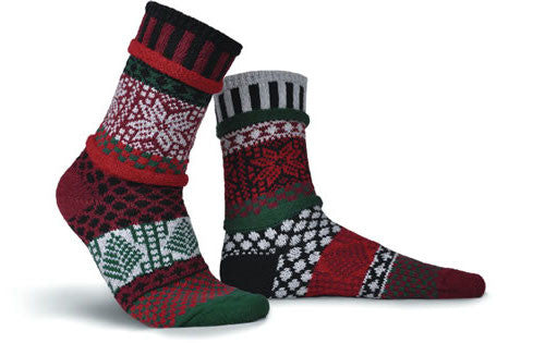 Solmate Socks Winter Series Poinsettia Sock is designed in Colors of Black, Pomegranate, Forest Green, Aluminum Grey, and Cranberry Red. It is mismatched with the Poinsettia Flower in the top and a Christmas Tree at the Bottom.