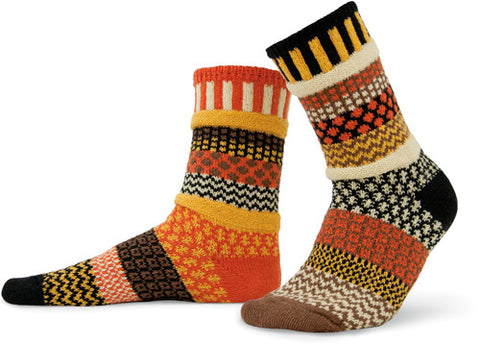 Solmate Socks Autumn Series Scarecrow Sock looks like Halloween and Thanksgiving Autumn colors. Mismatched the colors are Black, Yellow, Cream, Orange and Brown yarns.