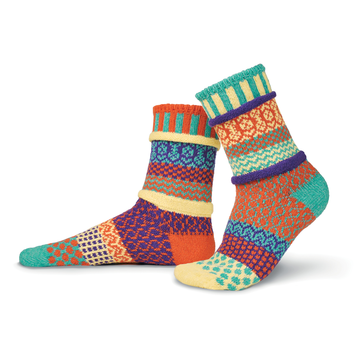 Solmate Socks Stellar Series Dawn Sock is all about the morning colors. As the sun starts to lighten the day and colors move from pastels to brighter. Dawns colors are Cream, Orange, Sea Foam Green and Purple.