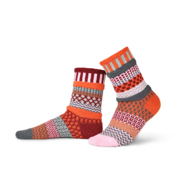 Solmate Socks Vermont Garden Persimmon Sock is a mismatched on purpose sock with Burnt Orange, Pomegranate Red, Pale Pink, Aluminum Grey and Porpoise Grey. The Wavy Lines, Squares and other Graphic switch places on each sock but look great together.