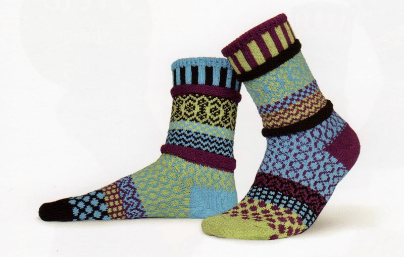 Solmate Socks Stellar Equinox Sock is a Mismatched Sock with a lot of Geometric figures and the Infinity Sign. The colors are Lime Green, Turquoise, Purple and Black.