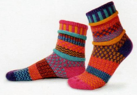Solmate Socks Vermont Garden Carnation Sock is a Mismatched fun print design of geometric whimsy. The Colors are Fuchsia, Turquoise, Purple, Yellow and Orange.