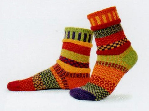 Solmate Socks Vermont Garden Daffodil Sock looks like it just came out of the Garden. It is a Mismatched Sock in Bright Colors of  Orange, Yellow, Red, Lime Green and Dark Purple.