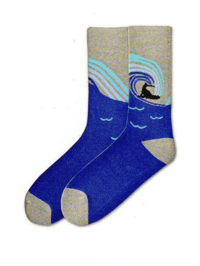 K Bell Mens American Made Surfs Up Novelty Sock starts with Grey at the Cuffs, the Heels and Toes are also Grey. Next comes Navy Blue background. The wave is Navy Blue, Sky Blue and Turquoise. The Surfer and Board are Black Silhouettes.