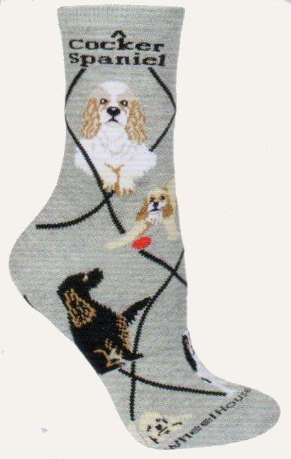 Wheel House Designs 3 Cocker Spaniels starts on a Grey background with Black Diamond Lines. There are 2 Profiles of the dogs at the top along with the breed name Cocker Spaniel. This sock has the most known colors for Cocker Spaniels represented on this sock in Poses below.