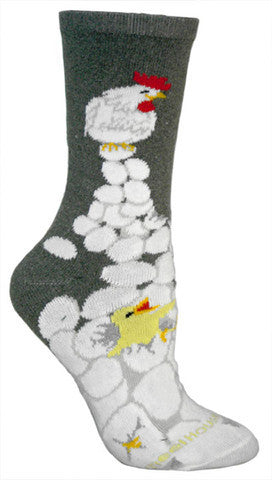 Wheel House Designs Chick N Eggs Sock shows a large pile of White Eggs with a few Yellow and Orange Chicks with a Hen on the top of the pile.