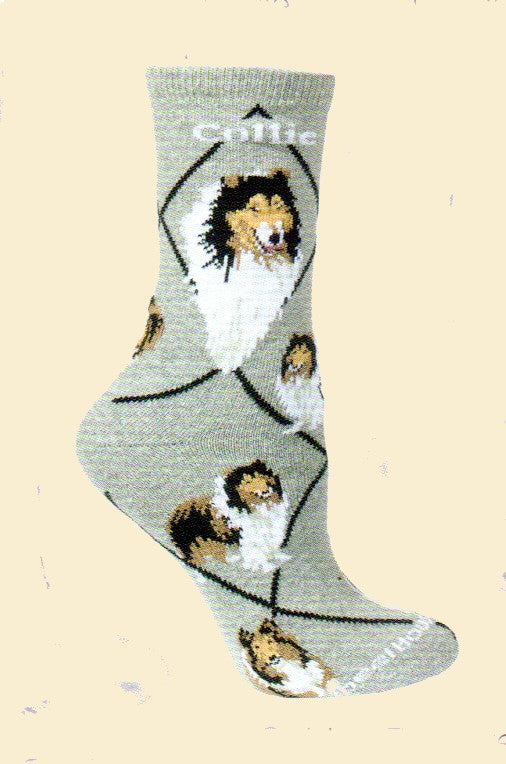 Wheel House Designs Collie Sock starts on a Grey background with Profiles of the Collie and then Poses all over the sock.