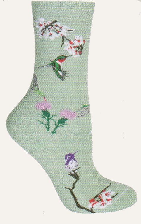 Wheel House Designs Hummingbirds on Lime Novelty Sock has all different types of Hummingbirds getting nectar from flowers.