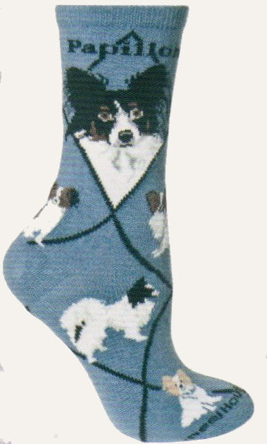 Starting on a Blue background the Papillon Novelty Sock has Black Diamond Lines and the Name Papillon in Bold Black Print. The Portraits are Black and White with some Brown. The poses are Standing  and Sitting. The last one shows it also comes in a Tan color.