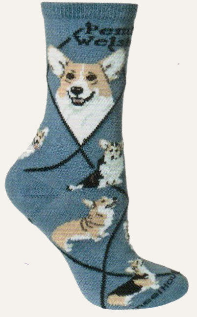 This Sock starts out on a Blue background with Bold Black writing of Pembroke Welsh Corgi. The Diamond Lines are Black. The Portraits are Fawn and White. The Poses show different colorings and markings they can come in with standing and sitting poses.