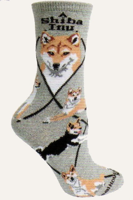 Shiba Inu Sock starts on a Grey background with Black Diamond Lines and Bold Print reading, Shiba Inu on top. The Portraits are in Camel, White and Black. The poses show off Standing, Sitting and Laying down. One shows the Black color option for the Shiba Inu..