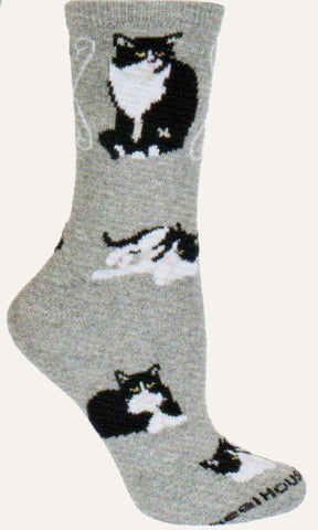 Wheel House Designs Tuxedo Cats on Grey background shows Poses of different Tuxedo Cats. Two large ones at the top and smaller cats around the sock.
