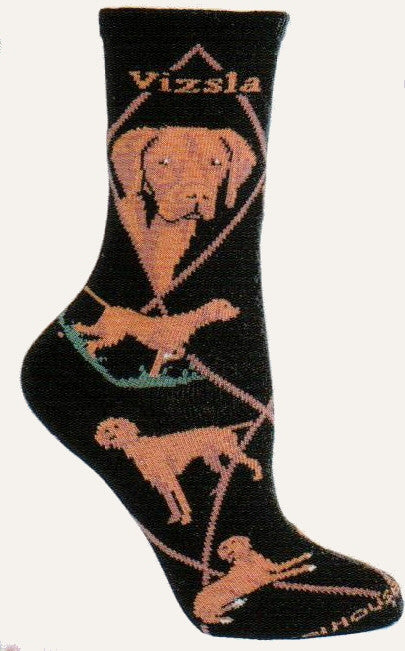 The Vizsla Dog Sock starts on Black with Rust Diamond lines and Vizsla in Bold Print. The Portraits are Rust, Chocolate Brown, Black and White. The Poses are a Stance, Laying Down, Hunting in Dirt and Green Grass.