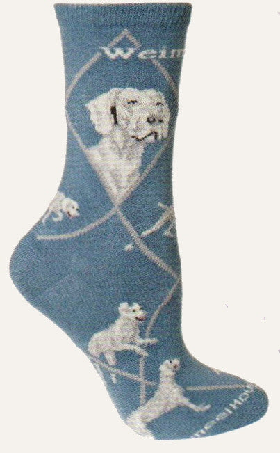 This Weimaraner Sock starts on Blue background with Light Grey Lines making the Diamonds and Medium Grey spelling out Weimaraner. The Portraits are Grey, Light and Medium, Black and White. The Poses are a Stance a Point for Hunting  Laying down and Running.
