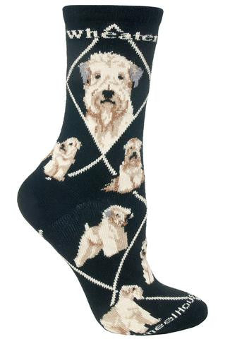 Wheel House Designs Wheaten Sock starts on a Black background with White Diamonds all over the Sock. Wheaten is in White Bold Print on both sides under the cuff. The Profiles are Frontal and Side Views. The Poses are Sitting, Standing, in a Show Stance and Laying Down.