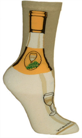 Wheel House Designs White Wine Sock shows a White Wine Bottle. In Yellows and Tans this Sock looks like a bottle with a Logo on it with White Wine and Green Grapes. Below on the Foot is another Glass of Wine.