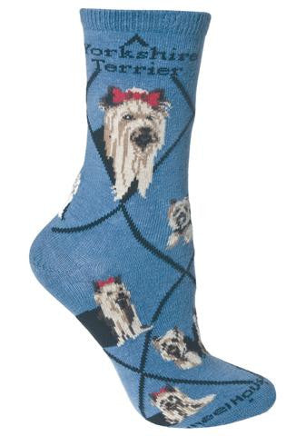 Wheel House Designs Yorkshire Terrier on Blue Sock starts with the Black Lines making Diamonds. On both sides of the sock reads, Yorkshire Terrier. The Portraits are both Frontal Views one of a Show Dog and One of a Home Body Dog. They are both Black and Tan. Also a unique feature on this sock is the new addition of the Biewer Yorkshire Terrier that is White Black and Tan in the Poses. Poses are of both Show Dog Yorkies and Yorkies that are home companions.
