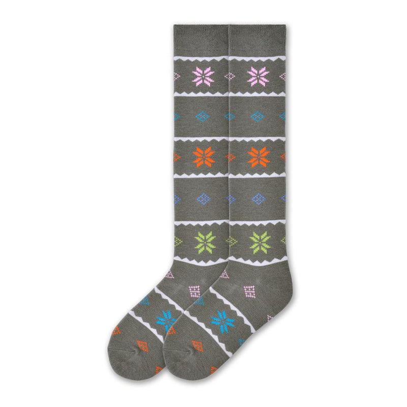 K Bell Womens Nordic Snowflake Knee High is made with a Wool Blend. The background color is Steel Grey. Cream Waves break up the sock into blocks. The Snowflakes are a Nordic design style. So are the Diamond and Squares in the patterns. Colors are Bright Pink, Cyan, Orange and Lime Green. Another row is Cerulean.