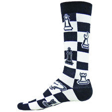 Wright Avenue Mens Chess Sock starts on a Black and White Chess Board. The Cuffs, Heels and Toes are Black. Pieces on the Board are Black and White. There are Bishops, Rooks, Pawns and more.