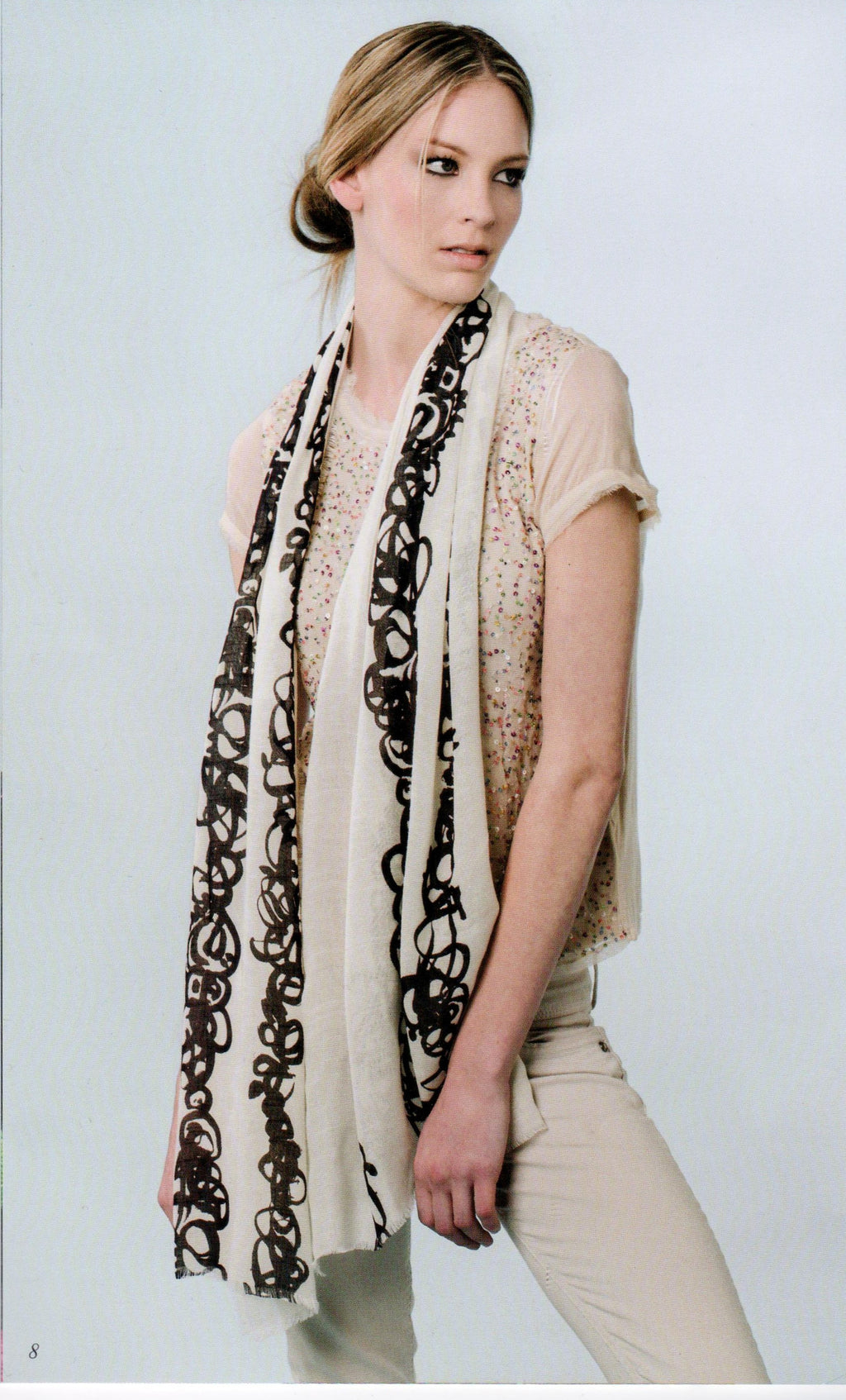 Model wearing Zazou Calligraphy Scarf draped across her neck and down her front.