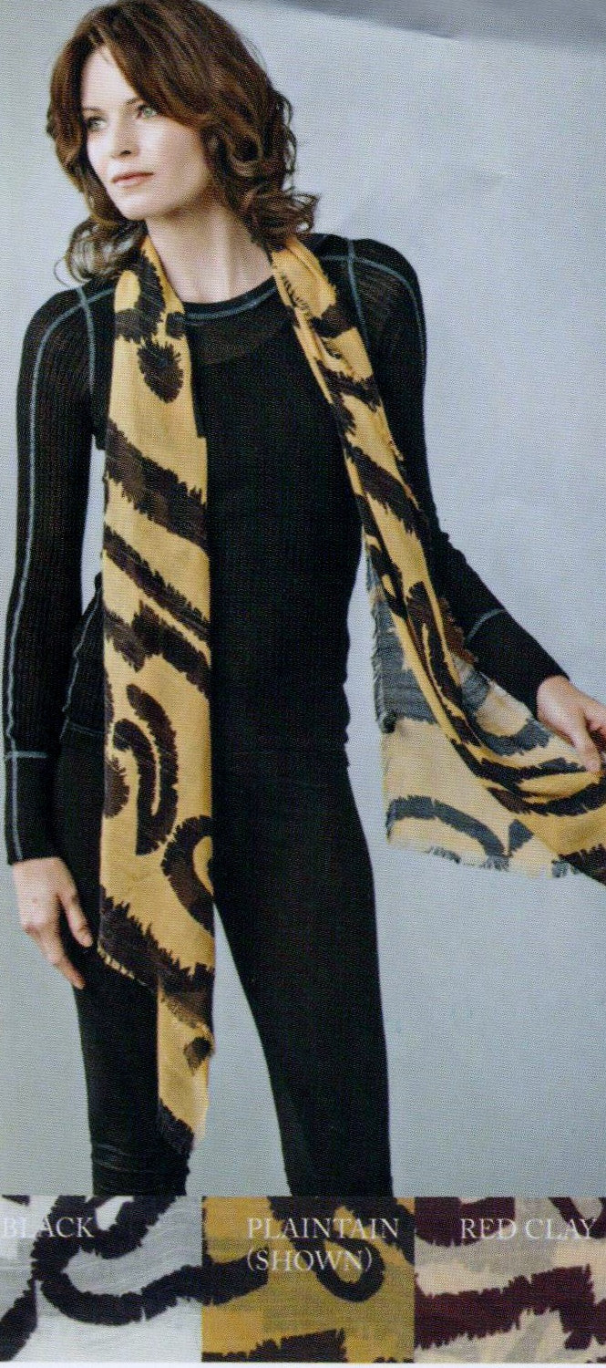 Zazou Serengeti Scarf in Plantain is being shown by the Model