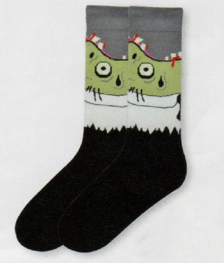 K Bell Mens Zombie Socks is a Guy wearing a Black Suit and White Shirt with a Red Tie. The only problem is he is Green and Bleeding.