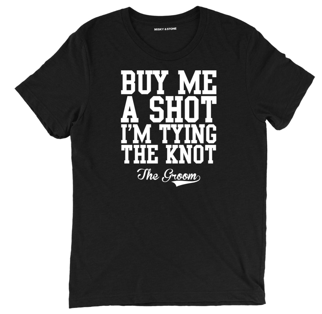buy me a shot hes tying the knot groom squad tee shirt, buy me a shot hes tying the knot groom squad apparel, buy me a shot hes tying the knot groom squad merch, buy me a shot groom squad clothing, buy him a shot bachelor party tee shirt, buy him a shot hes tying the knot bachelor party apparel, bachelor party merch, funny bachelor tee shirt