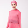 Woman in pink shirt with matching pink HAWA headwrap.