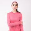 Woman in pink shirt with matching pink HAWA headband.