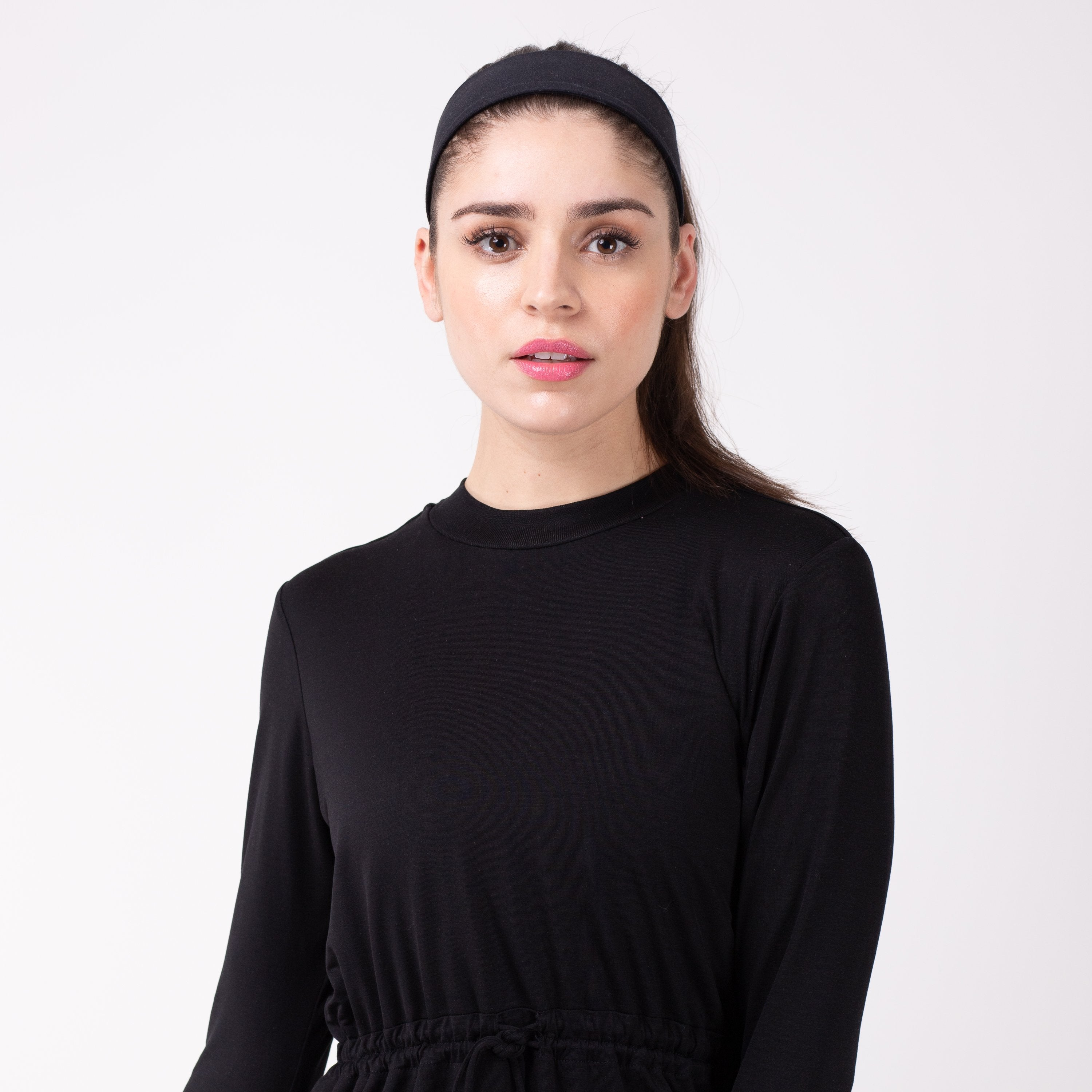 Woman in black shirt with matching black HAWA headband.