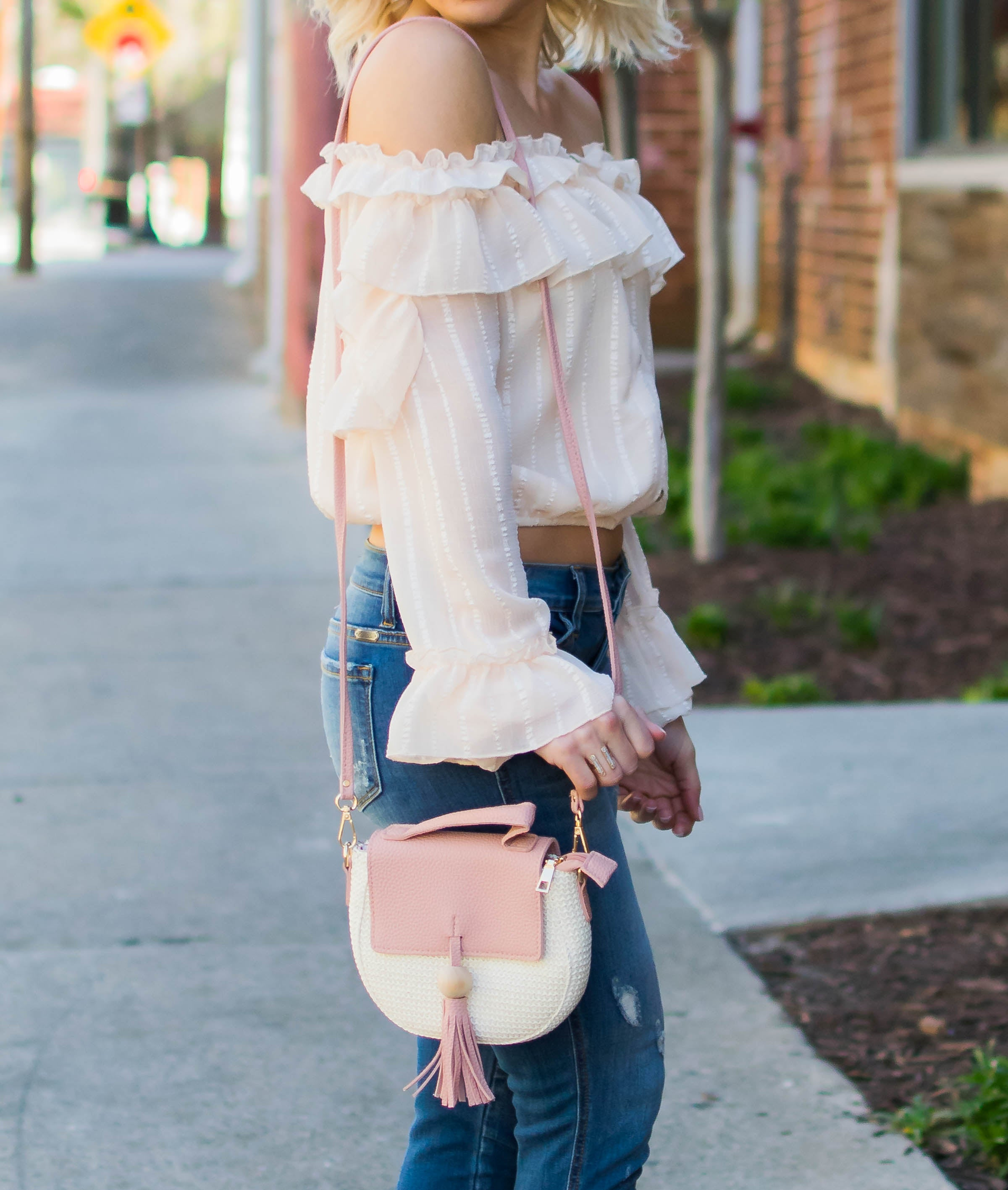 blush woven cross body with tassel