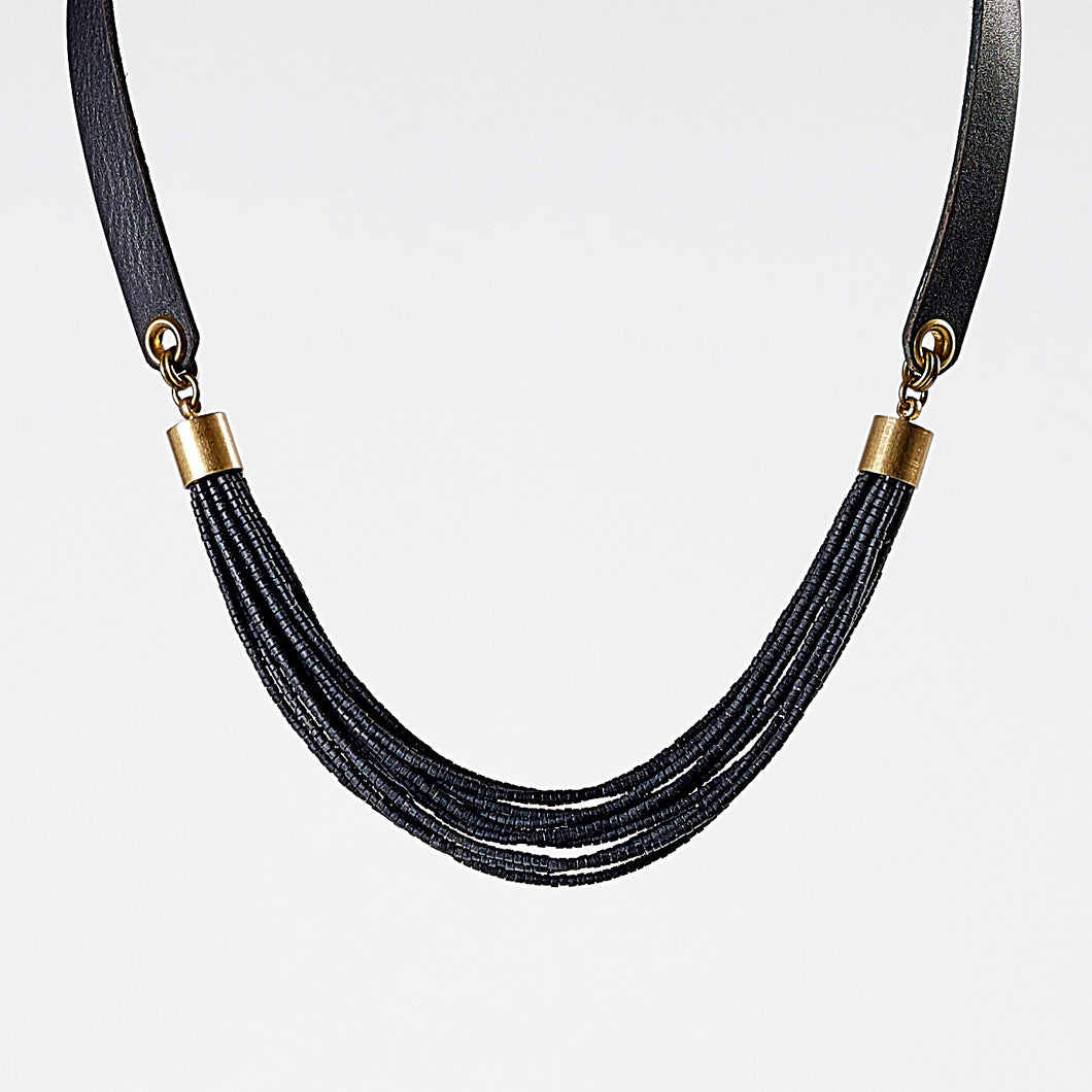 strapped messy L brass necklace #1