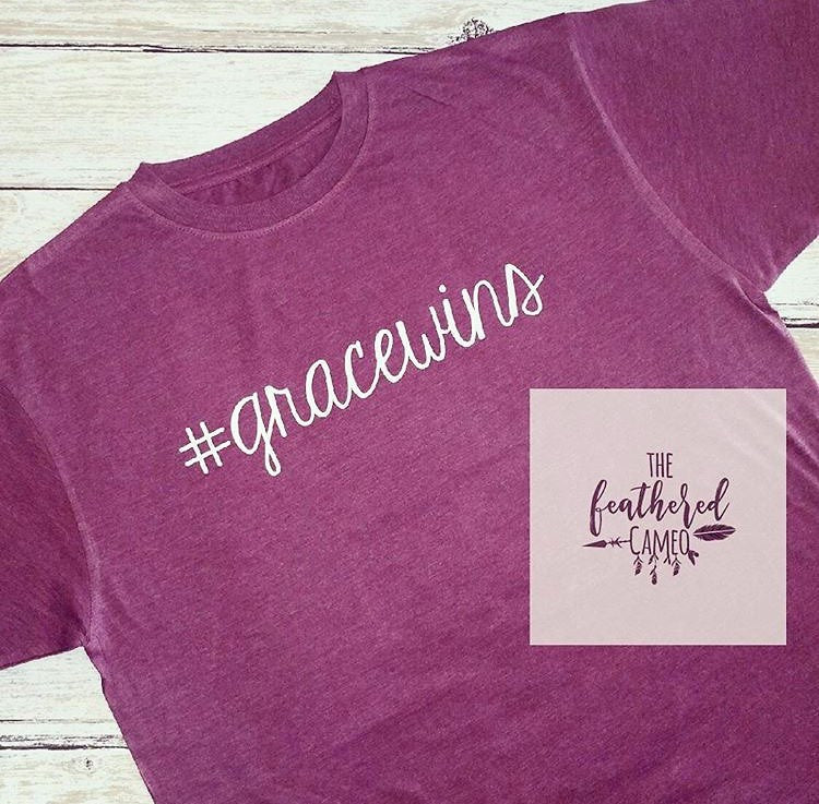 #gracewins T-Shirt by The Feathered Cameo