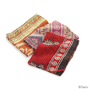 kantha dish towels in warm colors on a white background