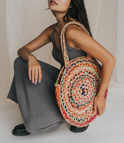 chindi woven colorful tote on model in grey dress