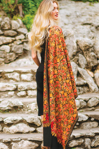 woman orange silk shawl over shoulder