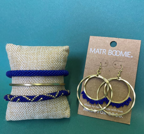 KY blue jewelry set. blue and gold stacked bracelets and earrings